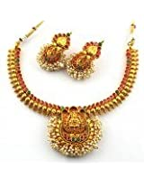 Anvi's traditional lakshmi (temple jewellery) necklace and earrings studded with kempu and clustered pearls
