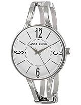 Anne Klein Women's AK/1715WTSV Glossy White Dial Silver-Tone Hinged Bangle Watch