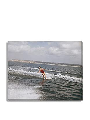 Photos.Com By Getty Images Woman Surfing On Sea By Tom Kelley On Canvas