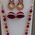 dark pink and gold necklace, earring and bangles