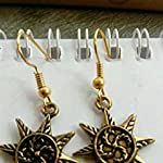 Antique gold earring by mvk