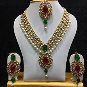 Dazzling kundan set in red and green with white pearls