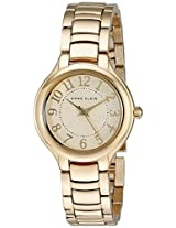Anne Klein Women's AK/2008IVGB Easy-To-Read Gold-Tone Watch  and Link Bracelet