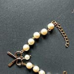 Stylish Bow pearl Golden Charm Bracelet