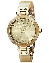 Anne Klein Women's 109652CHHN Gold-Tone Horn Plastic Bezel and Bangle Bracelet Watch