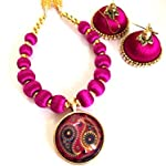 Magenta and gold bead necklace with small pendant and jhumkas