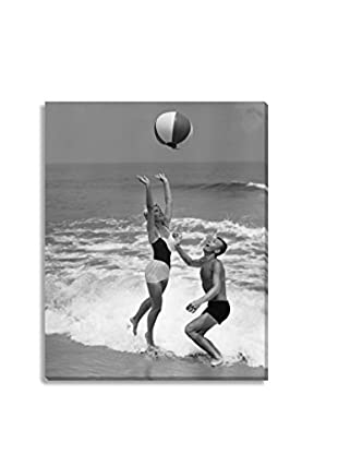 Photos.Com By Getty Images Young Couple Playing With Beach Ball On Canvas