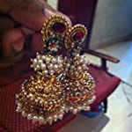 Designer Gold Plated with gold Polish jhumkas.