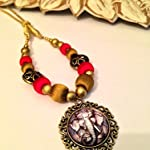 Antique gold framed Ganesha pendant on red and gold doll bead necklace
