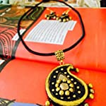 Gold and black Paisley pendant on silk cotton cord, with earrings