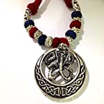 Silver maroon and blue bead necklace with snake pendant