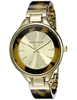 Anne Klein Women's AK/1408CHTO Swarovski Crystal-Accented Gold-Tone Watch with Tortoise Resin Bangle
