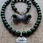 Exclusive handcrafted necklace set with earrings and bracelet.