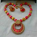 Yellow necklace with earrings