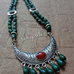 Handmade designer necklace with matching earrings.