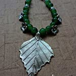 Exclusive handmade neckpiece with German silver leaf pendant .
