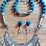 Handmade neckpiece with german silver pendant n velvet beads.