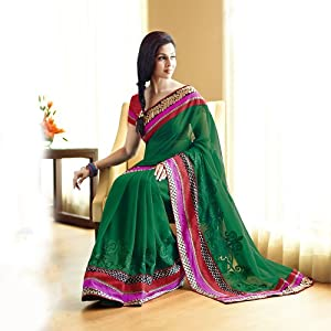 The Green embroidered designer saree with multi layer border.