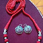 Set made with red cotton balls / Dori with German silver pendents.