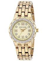 Anne Klein Womens AK/1508CMGB Swarovski Crystal Accented Gold-Tone Bracelet Watch