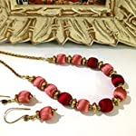 Pastel pink and maroon bead choker with antique gold beads and earrings