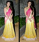 kajal aggarwal in beautiful yellow and pink embroidery half saree