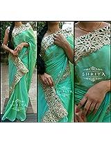 Shriya's Mint Green Chiffon Saree With a Rich Cutwork Gold Border Throughout.