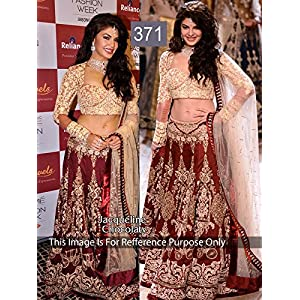 Bollywood Replica Jacqueline Fernandez Net and Moss Velvet Lehenga In Red and Gold Colour NC888