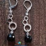 Silver rounds with black agates
